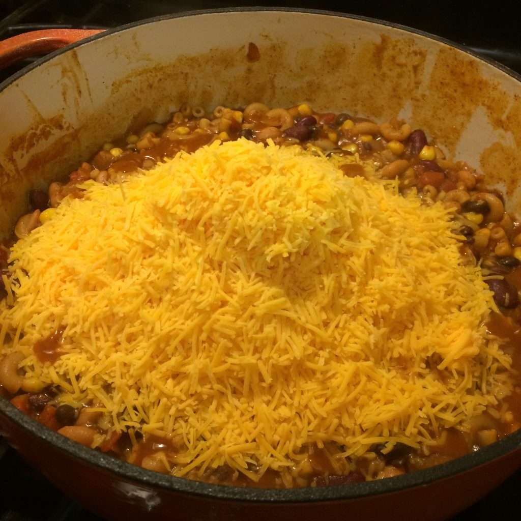 Adding the cheese to South of the Border Mac N Cheese